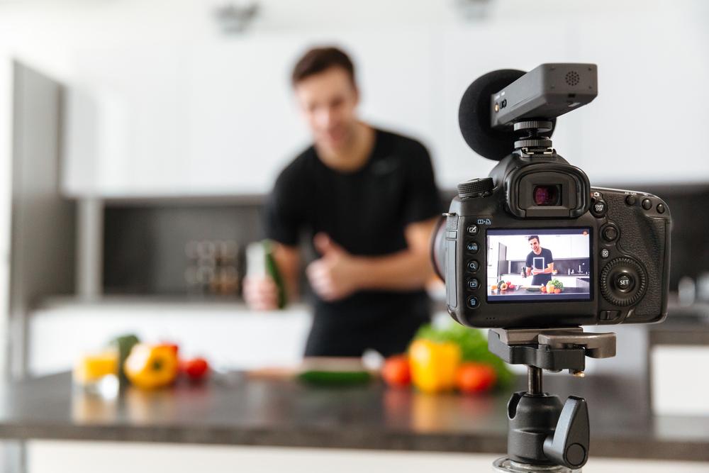 man-in-kitchen-taking-photos-for-blogging.jpg