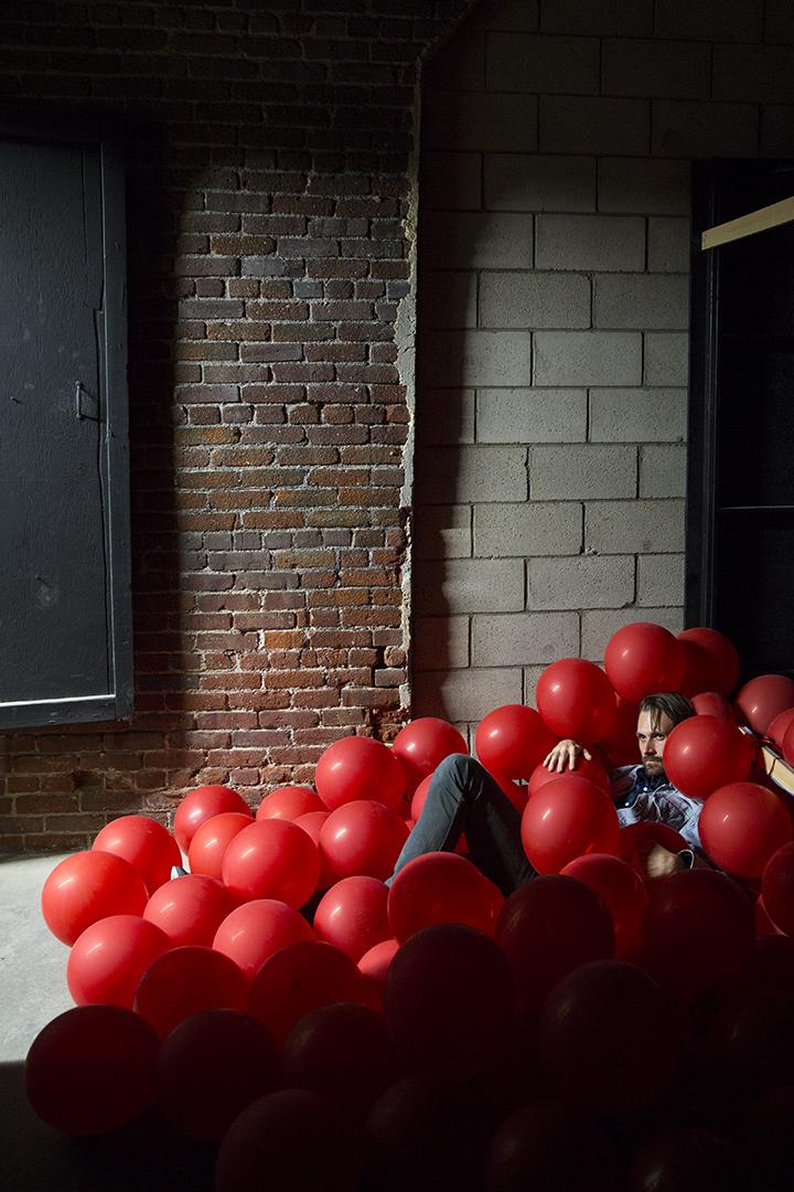 Galen in the balloons.jpg