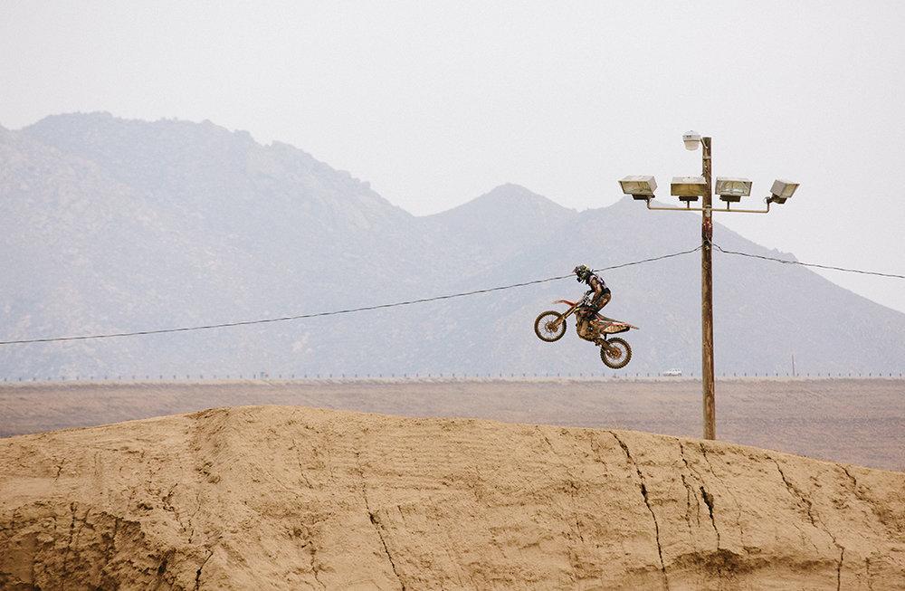 Dirt biker jumping Valvoline.jpg