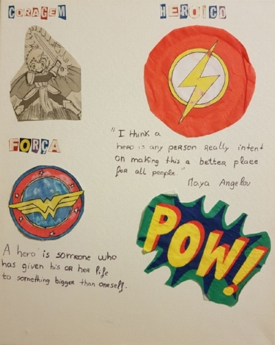 "This student's interpretation of ""what makes a hero"" includes well known super heroes, poet & activist Maya Angelou, and the act of being selfless."