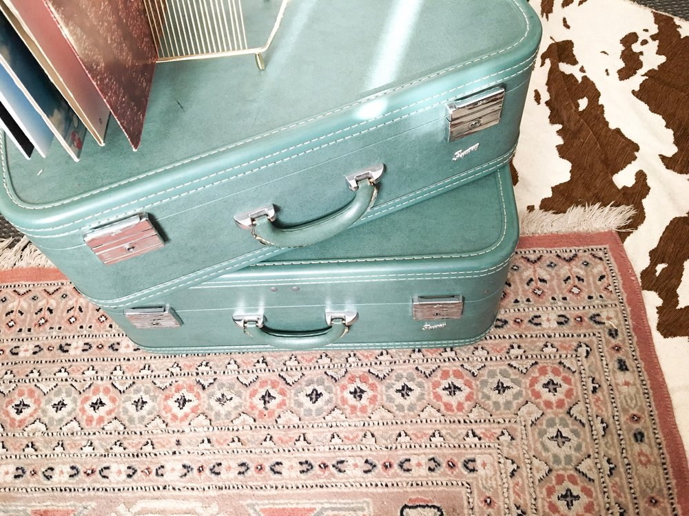 suitcases from a garage sale, rug from  house of vintage