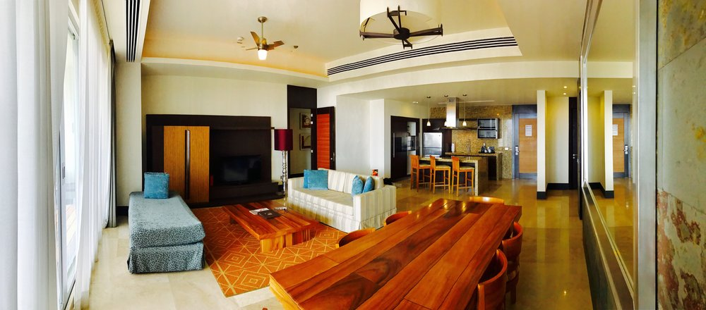 A view of the living room and kitchen of our amazing 2-bedroom suite for a week at Vidanta's Grand Luxxe in Nuevo Vallarta