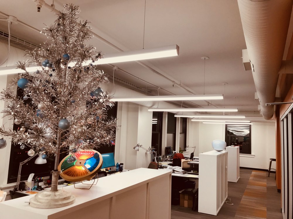 Decoratig the offices of Rottmann Collier Architects with a vintage aluminum tree and color wheel