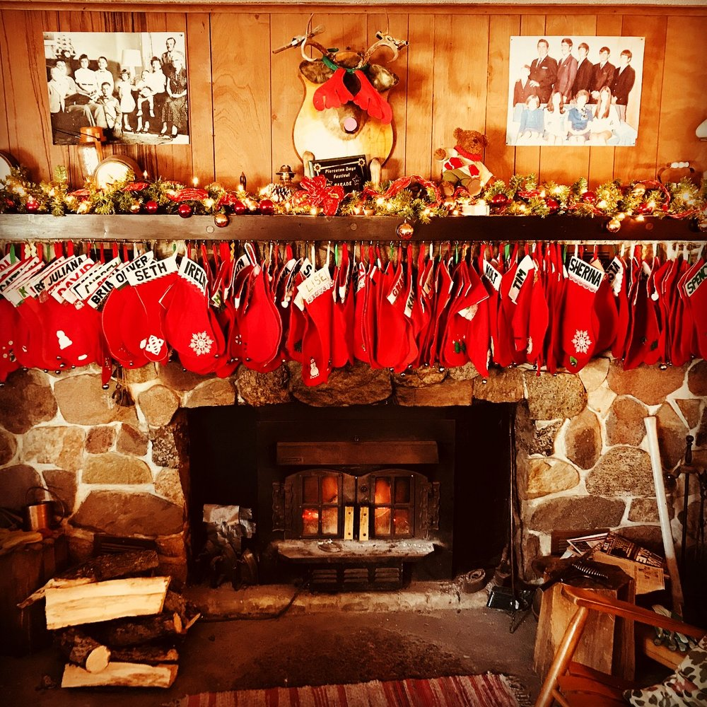 The 127 Stockings on Grandma's fireplace. Yes, she puts something in every single one (well, this year it was an honor to do it for her-under her very watchful eye)