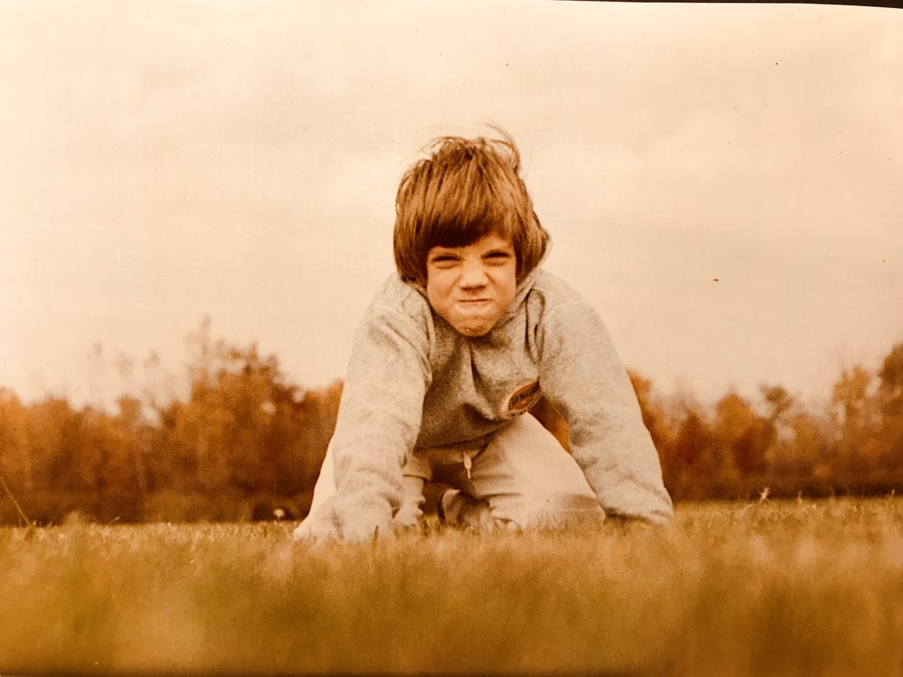 My cute husband playing football in his youth...