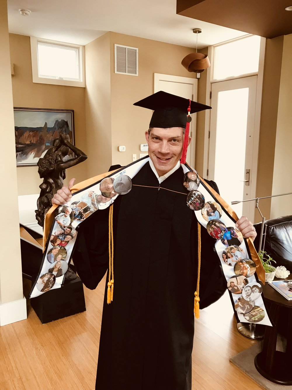 Buttons adorned his sash for each family member that could not attend his graduation ceremony.