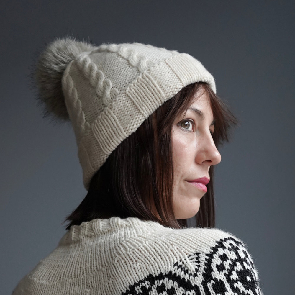 This is a great starter hat pattern for new knitters. It's knit flat, so no circulars or double-pointed needles required! Once you master the basic ribbed version, try adding cables to your technique arsenal.