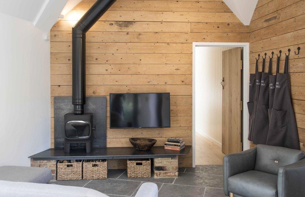 The Steading wedding accommodation with woodburning stove.jpg