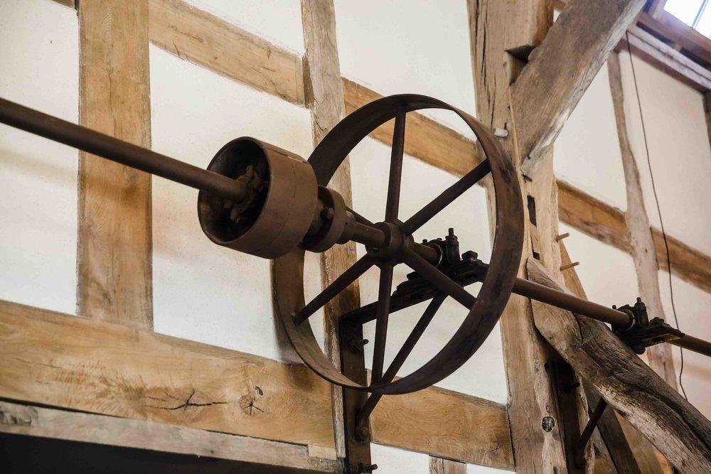 Old Farm equipment on wall of barn for web.jpg