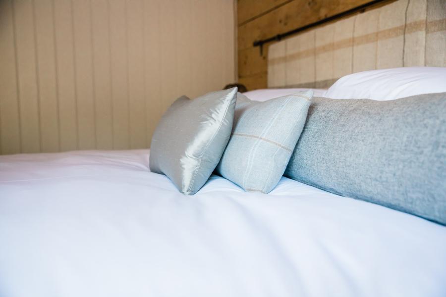 Blue cushions on white duvet.jpg