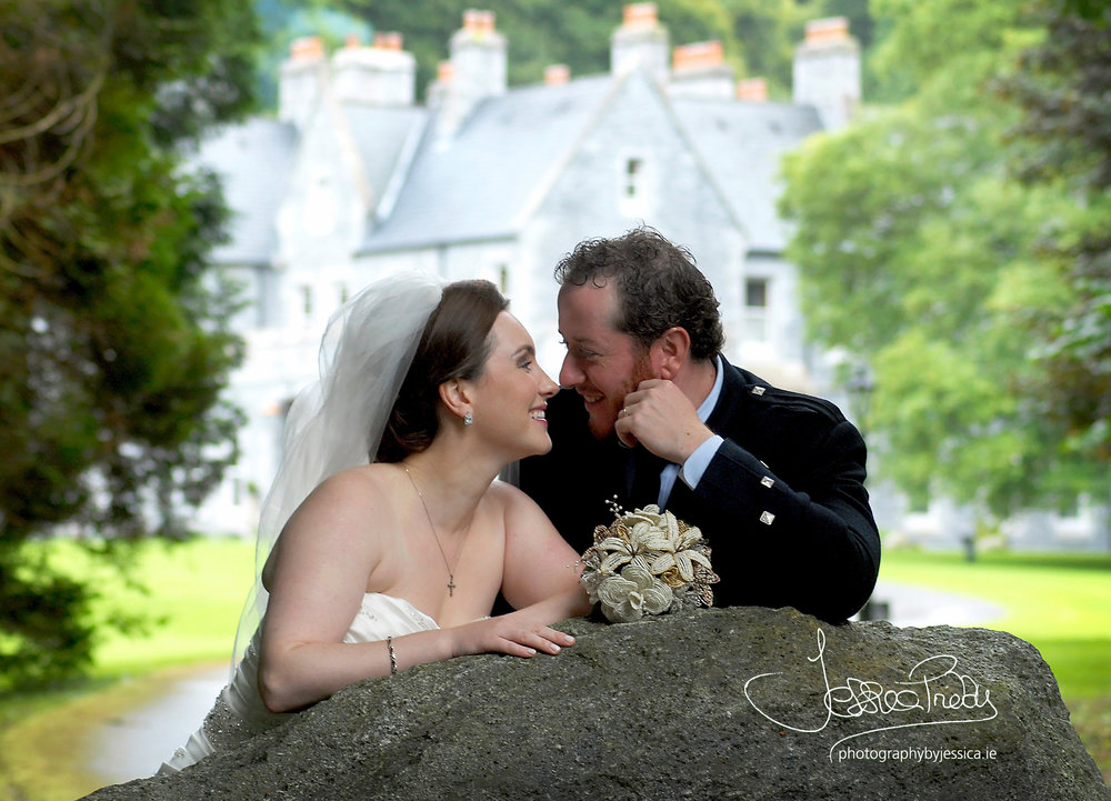 Bride and Groom in front of their Wedding Venue