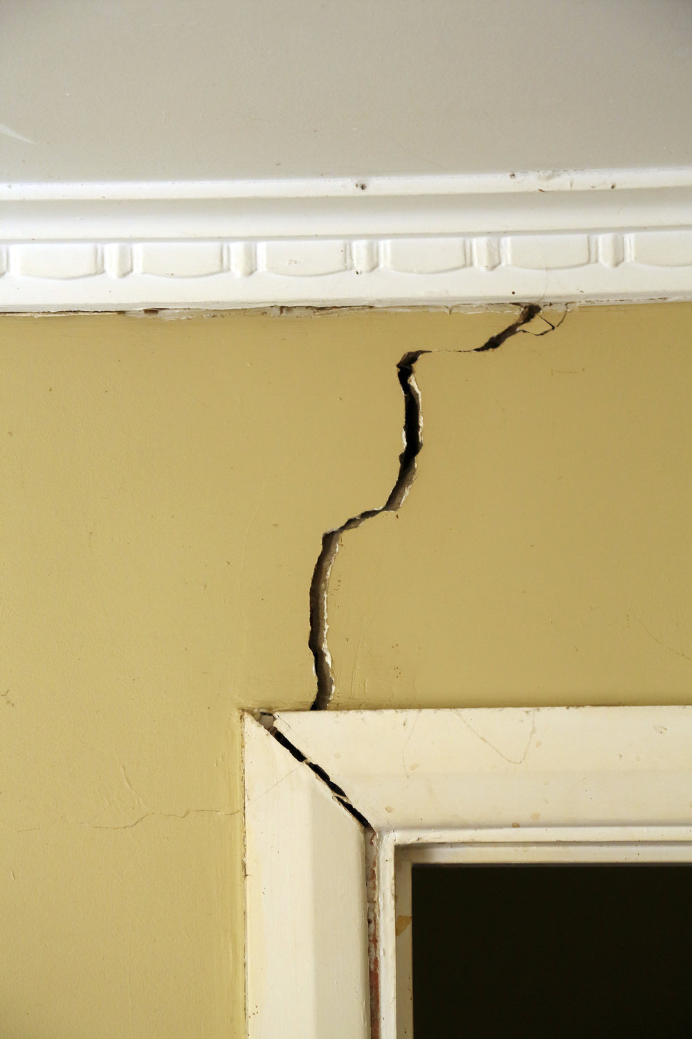 Internal cracking at 'weak point' within the fabric of the building.