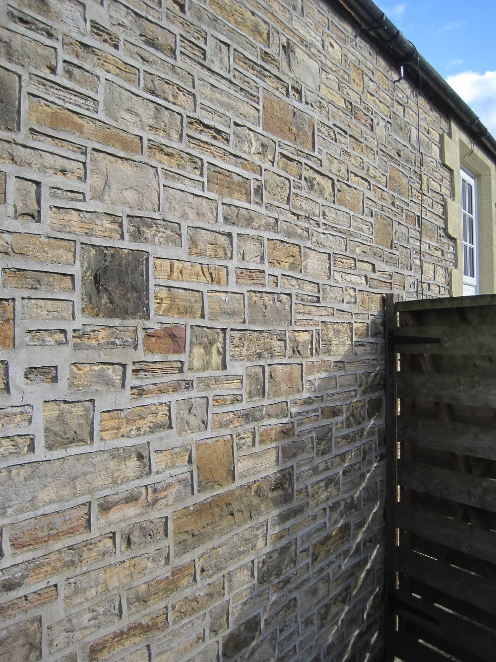 Ribbon style pointing on an old school house in Northumberland.