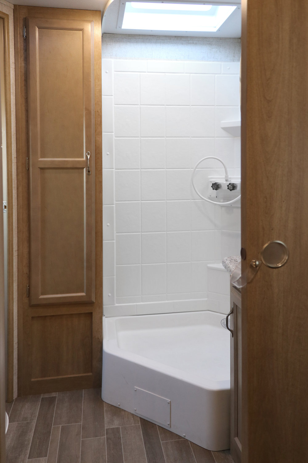 24 RLS Bathroom Shower and Linen Cabinet.jpg