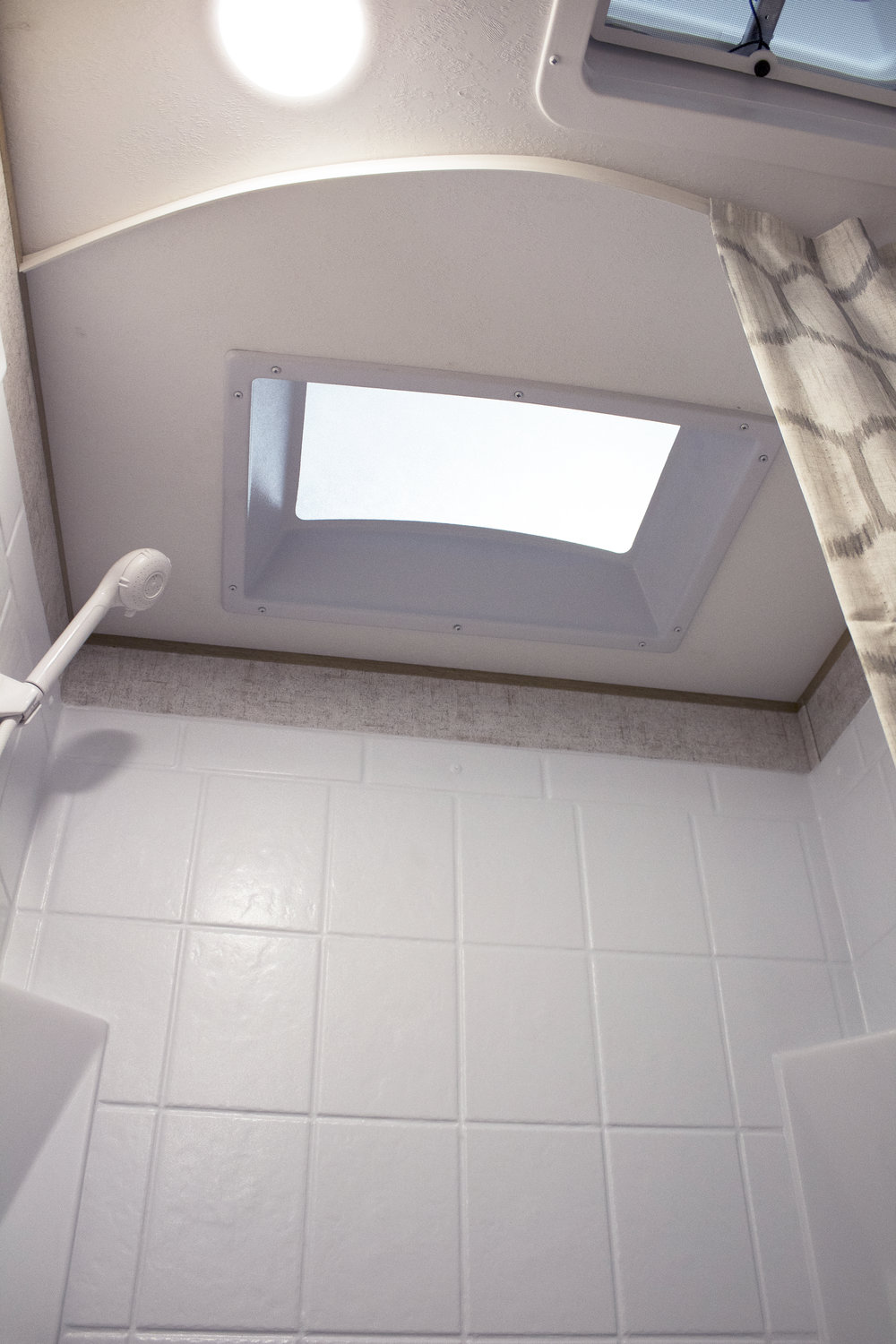 26 BH Bathroom Skylight and Ceiling Fan Vent.jpg