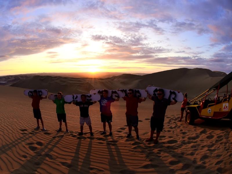 Sand boarding at desert oasis in Peru