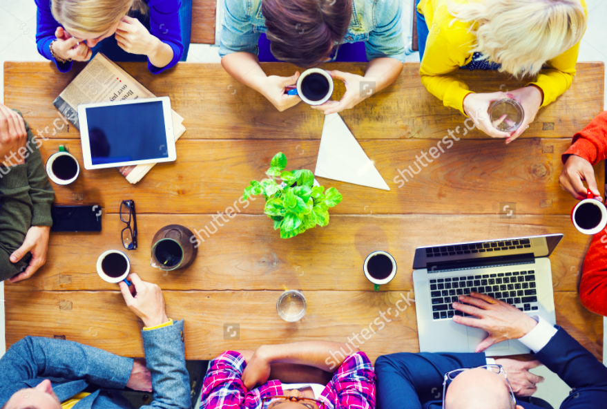 working desk with cool people in vivid colours with coffees and computers.png