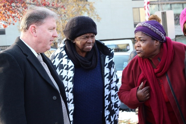 l-r Union County Sheriff Joe Cryan speaks with caregivers Odell Hill and Marie Gisele Joseph during a vigil held in front of AristaCare at Delaire nursing home in Linden. The workers are seeking a fair contract and restored benefits. (photo by Mary Alex)