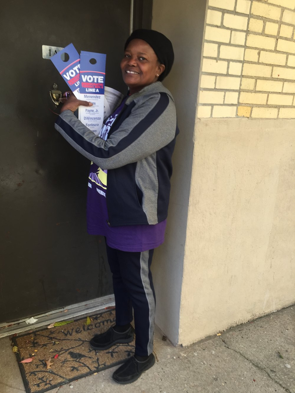 Marie Toussaint from Local 284, a cafeteria worker in Newark, knocking on doors in Newark for Senator Menendez.