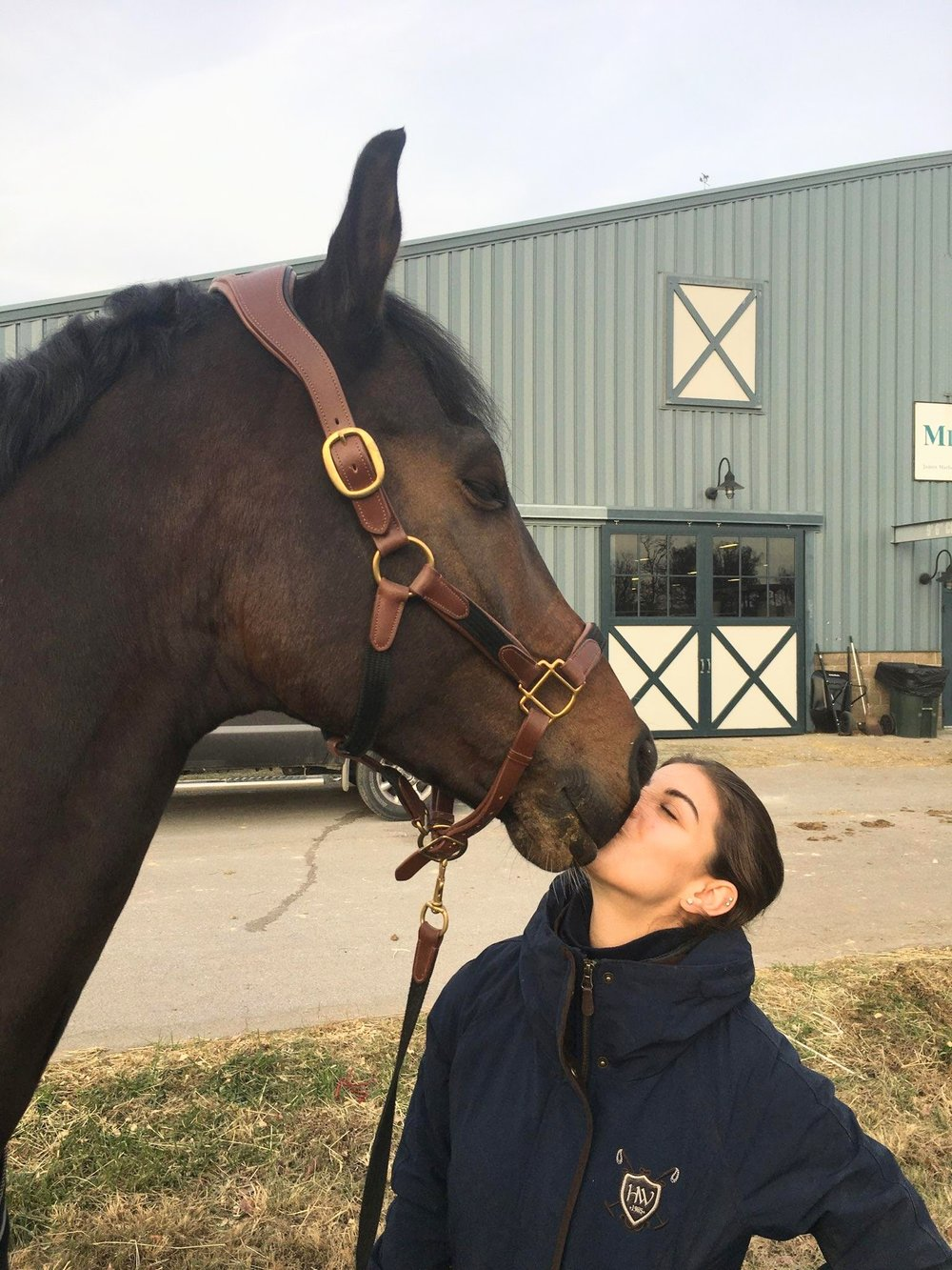 Maia has a kiss for the equine love of her life. (Photo courtesy of Maia Barnes)