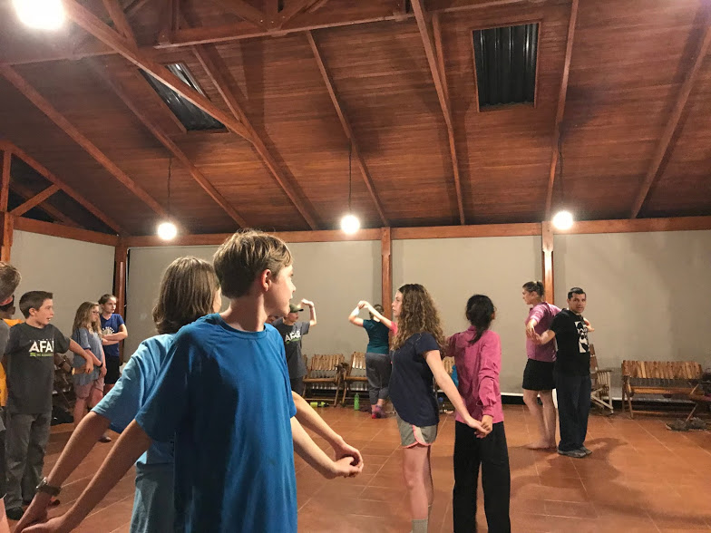 Learning new moves at our salsa dance lesson.