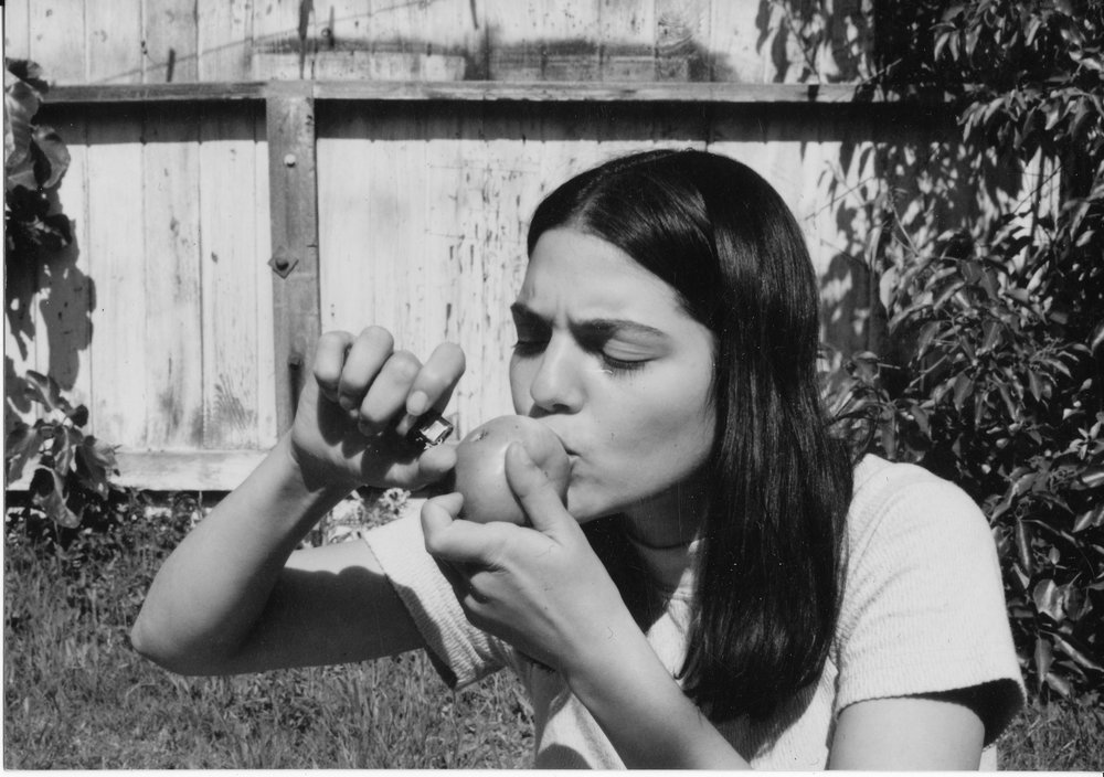 """Apple   """"I shot this image of a young smoker using her pipe of choice, it was shot in a backyard in Hermosa in 1988"""""""