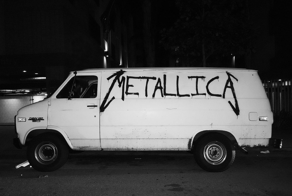 """Metallica Van    """"Half past midnight on a side street off Hollywood Blvd. I noticed this Metallica tagged van. Had to flip an illegal u turn and hop out for the shot.Nothing like a late night Hollywood spotting.""""    Geoff Moore"""