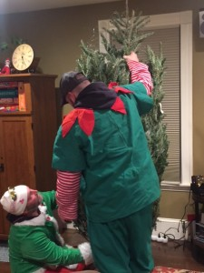elves setting up Christmas tree