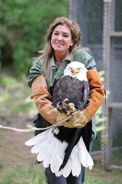Photo: Jane Veltkamp and Beauty the Bald Eagle. Photo Credit: Glen Hush.
