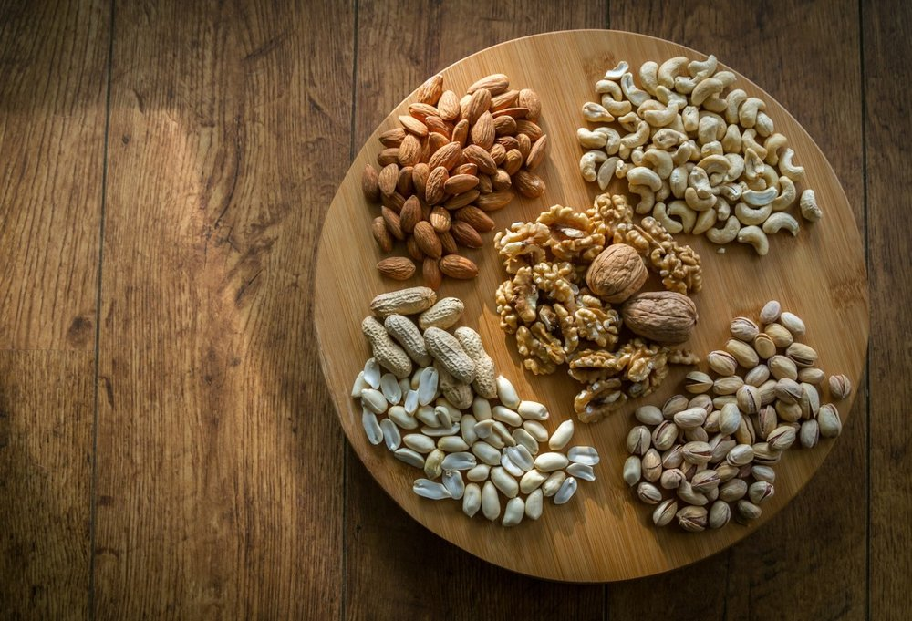 mixed_nuts_selection_brown_shell_food_tasty_wooden-264813.jpg
