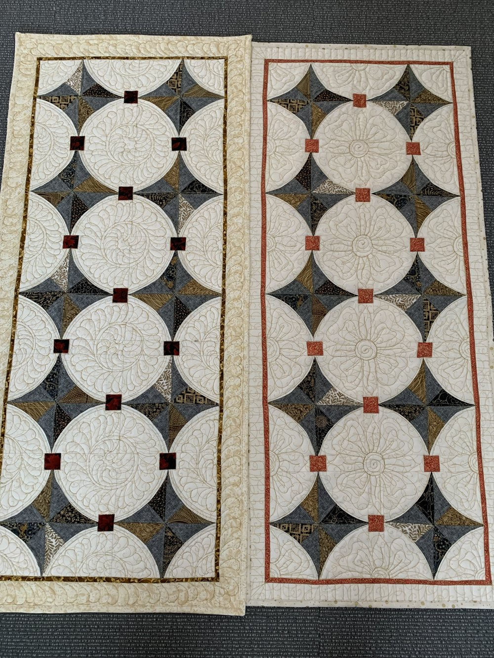 Both runners the same but different inside squares, borders and quilting.