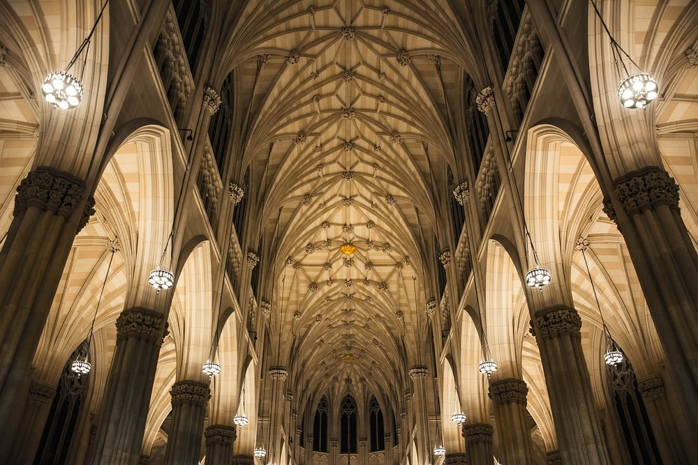 Example of the interior of gothic architecture. In the image we can see the Nave which leads to the Ambulatory. On the sides we see Pointed Arches held up by Piers and reinforced by Ribbing.