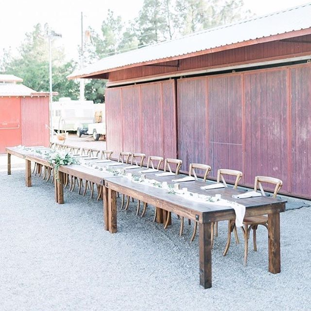 If you are going to have all your besties stand by your side during your wedding, you HAVE to have them sit by your side at the reception☺️ our farmhouse tables are laid out banquet style with our cross back chairs on one side to fit your whole squad! 📸 @j.annephotography  Venue: @legendsranchlasvegas