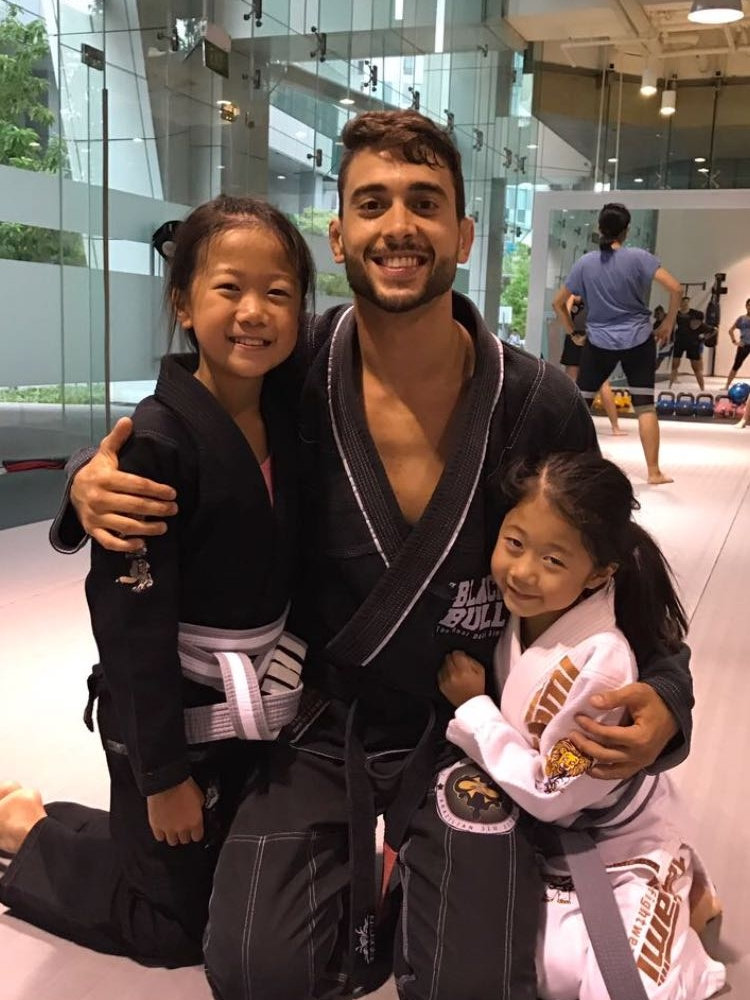 Grace and Sarah with their BJJ professor Marcelo