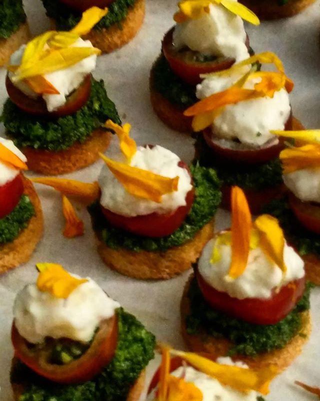 #BTS Plating Organic Heirloom Tomato and Buratta Crostini with Basil Pesto and Micro Flowers