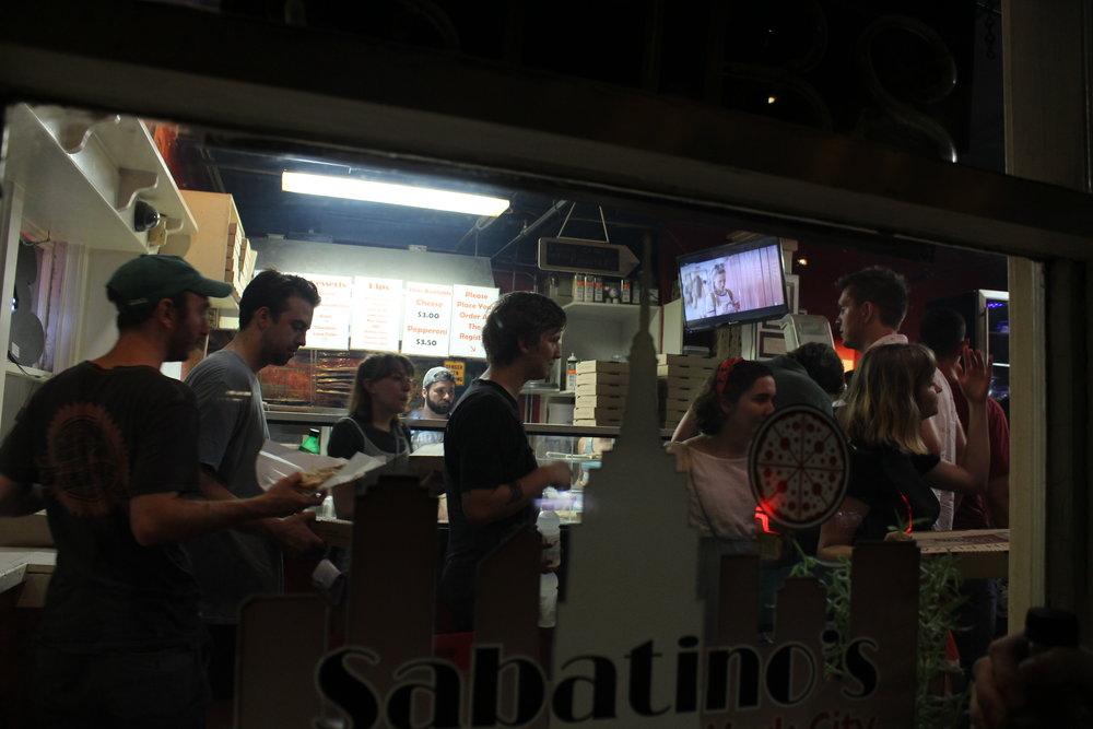 Dan Fetterolf, Timothy McFall, Minna Heaton, Jackson Wise, Emma Grabowski, and Molly Druga in Sabatino's Pizza