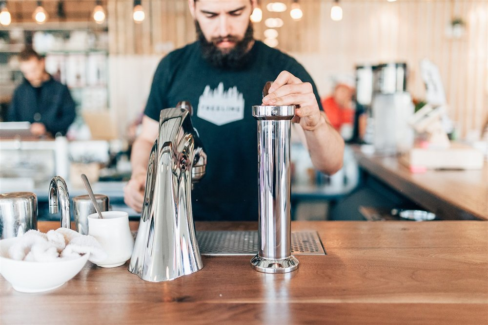 The coffee bar at Treeline Coffee's Roasting Room in Bozeman, MT serves interesting coffee knowledge alongside tasting flights, pour-over, affogato, macchiato, seasonal specials (like a lavender cardamom cortado) and more.  Stacy Townsend | Courtesy Treeline Coffee Roasters