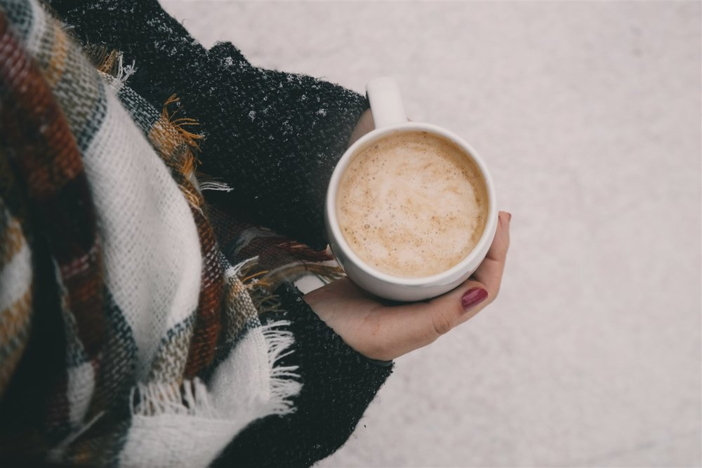 Excellent coffee and fresh snow are perfect partners.  Dreamstime