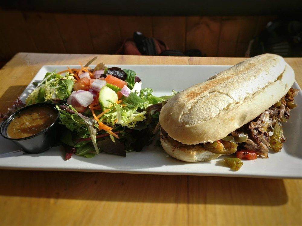 The Philly Cheese Steak sandwich takes a Canadian slopeside twist at  WH20  near  Nelson, British Columbia , Canada.  © Ski Travel Go