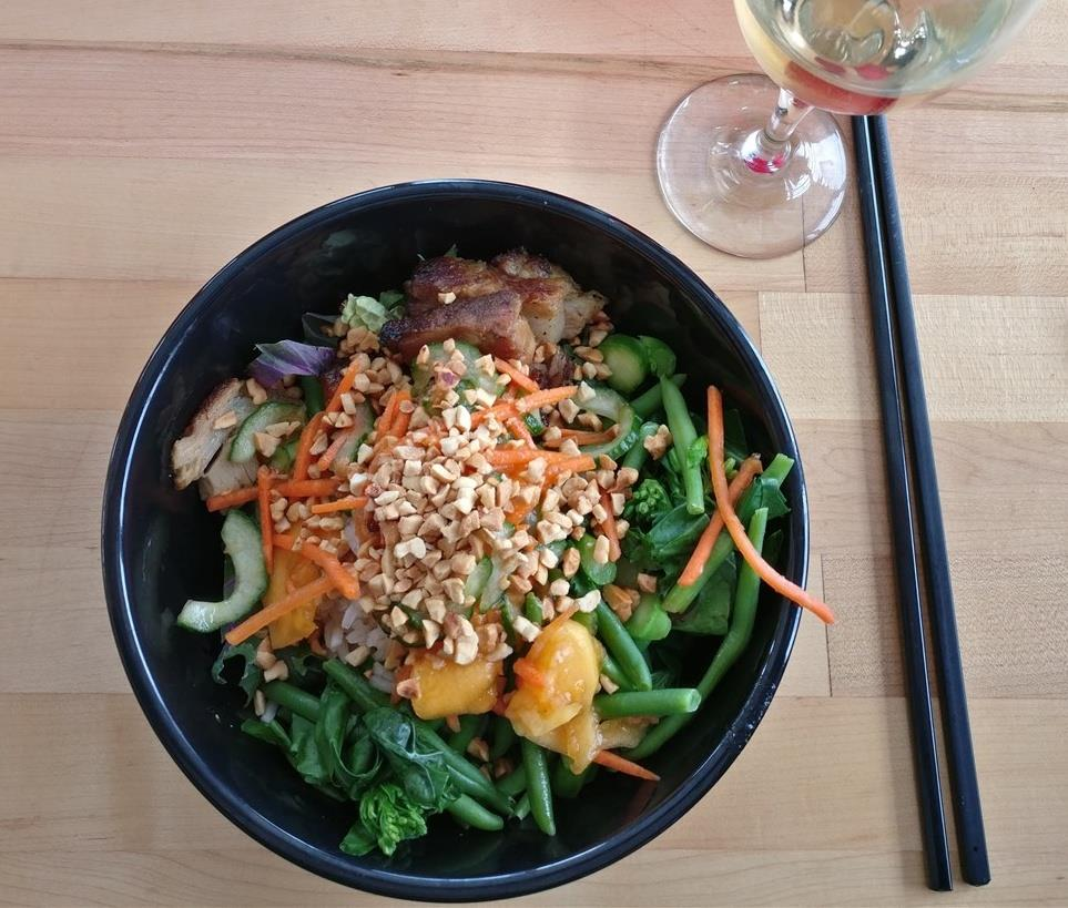 Inspired by Southeast Asian cuisine, this yumsville rice bowl is customized for each diner at the wok station in the fast casual servery at Rendezvous Lodge atop  Blackcomb Mountain .  © Ski Travel Guru