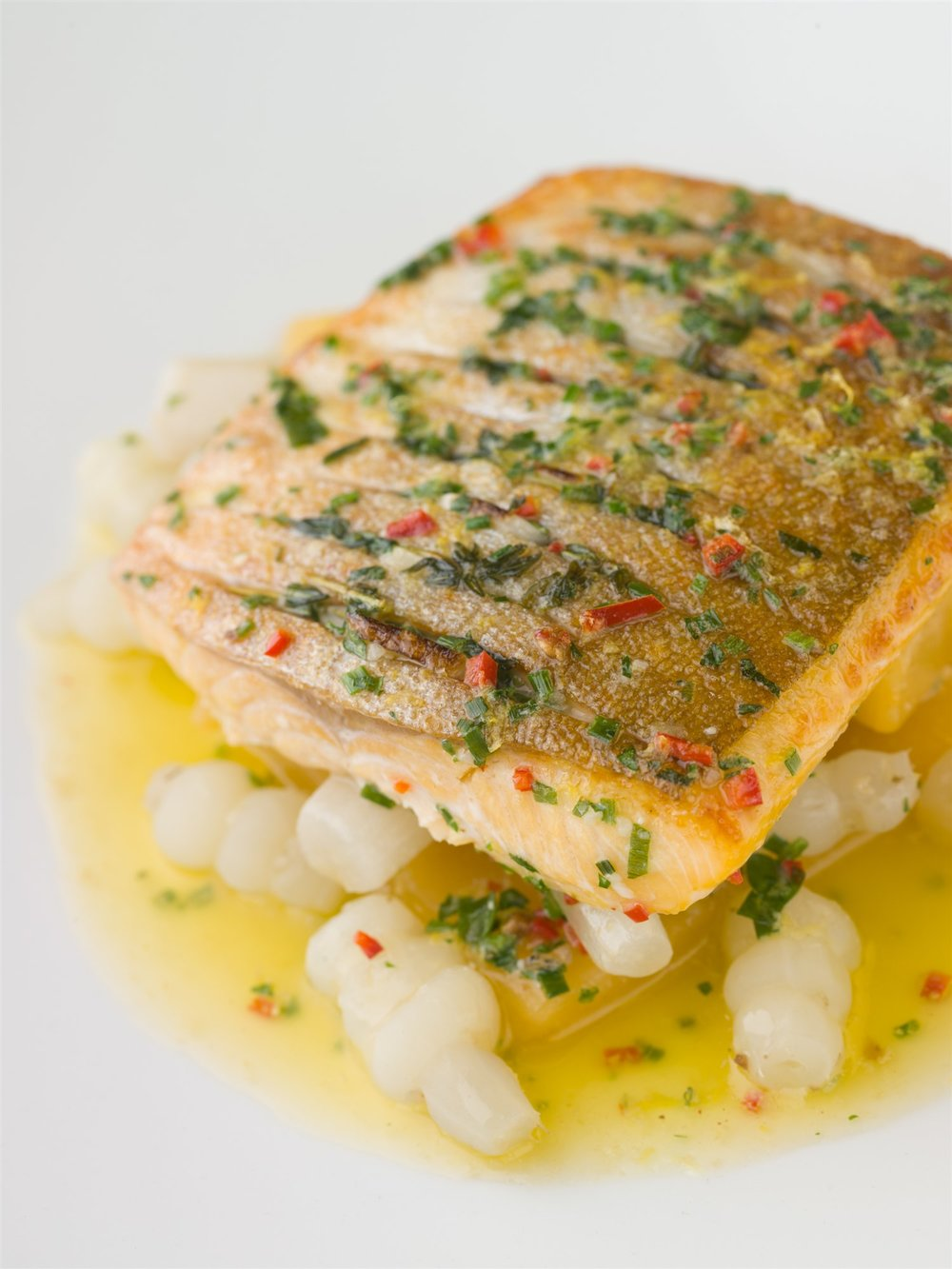 Arctic char over crosnes (Chinese artichokes) in lemon butter, at  Araxi .  John Sherlock | Courtesy Toptable Group