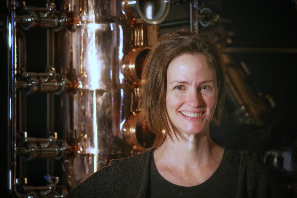 Sometimes the wizard is a woman: Fernie Distillers' head distiller Jillian Rutherford and her custom-crafted copper still.  © Ski Travel Guru