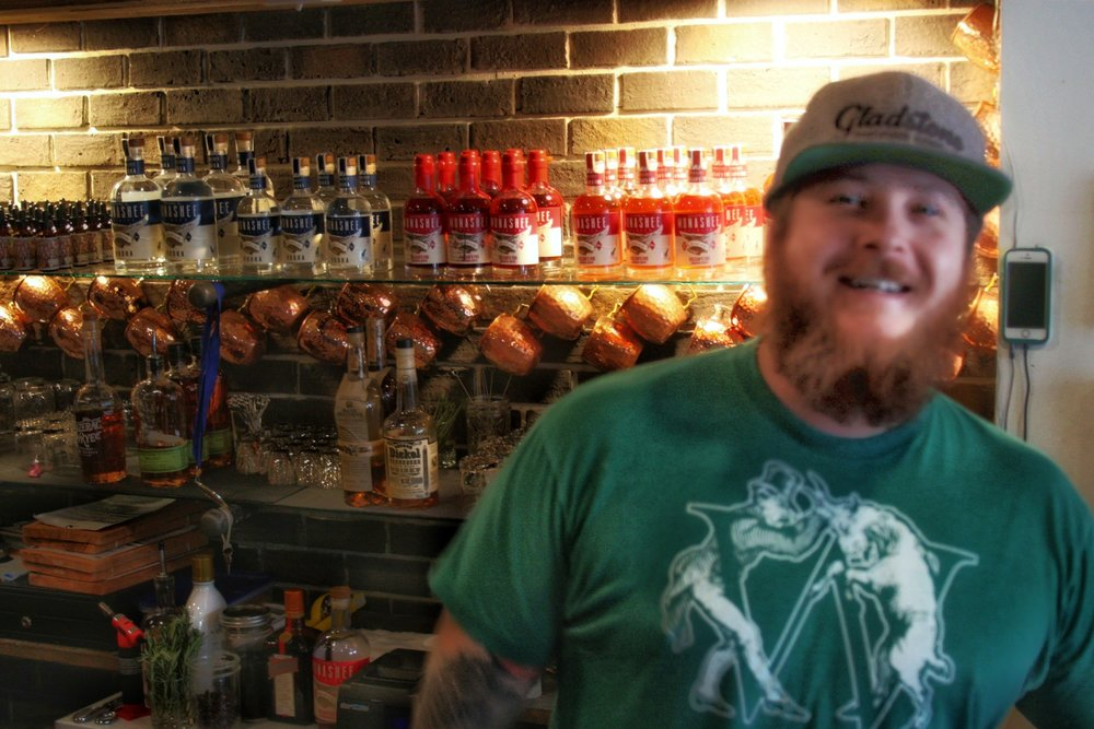 Josh McClafferty's big, welcoming personality and passion for distilling make him a happy natural behind the bar.  © Ski Travel Go