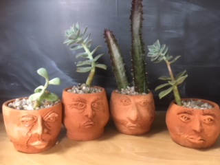 Face Pots with Succulents - $35 each