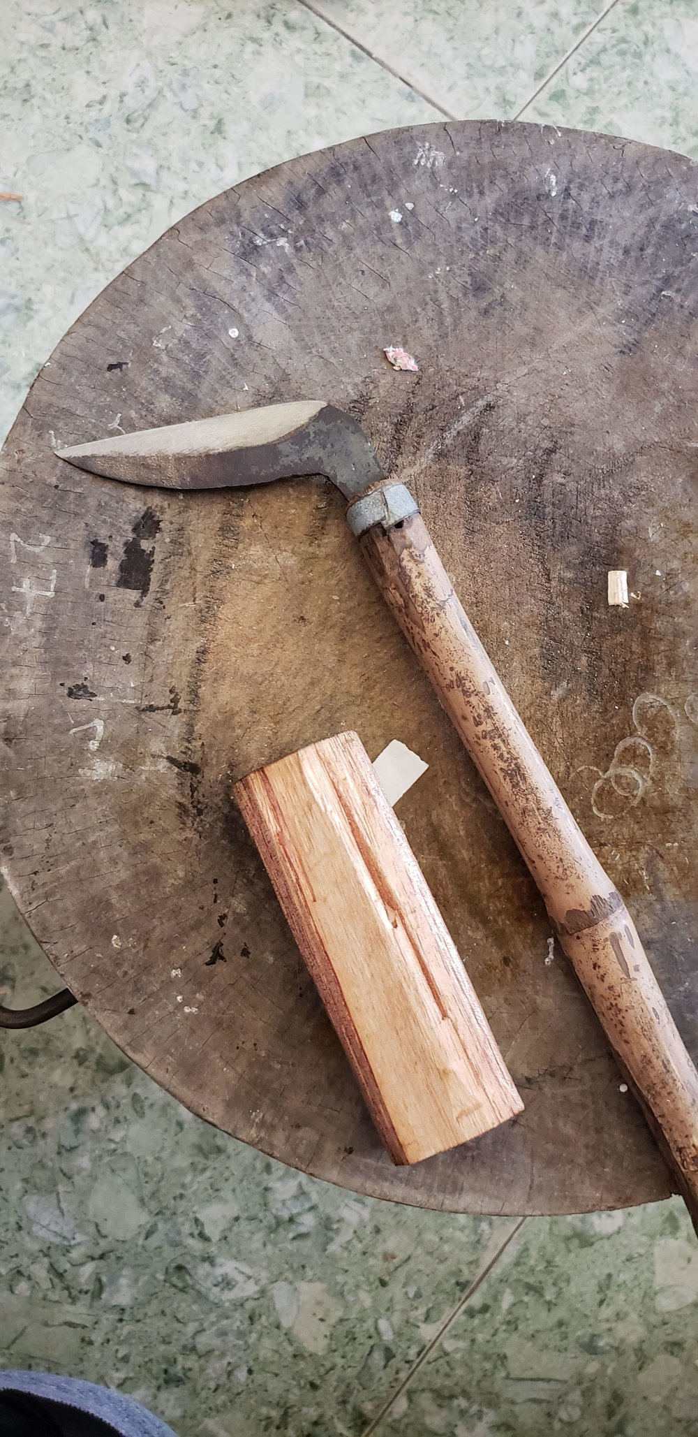 The block of wood for the handle and the knife to carve it