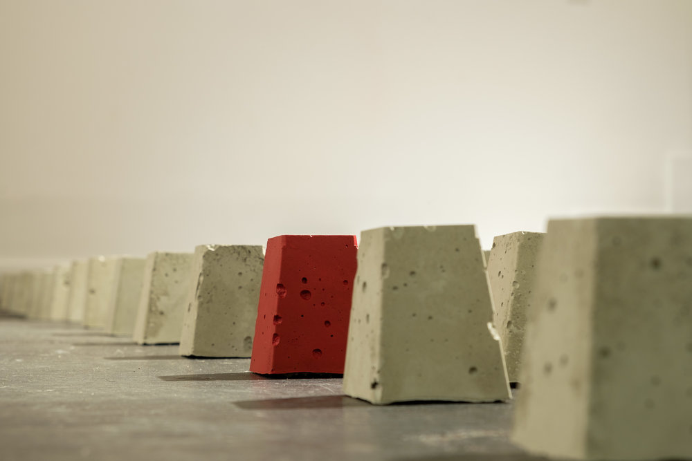 Politics of Inequality.  Detail of 135 concrete pedestals. 2.2 x 2.2 in (each)