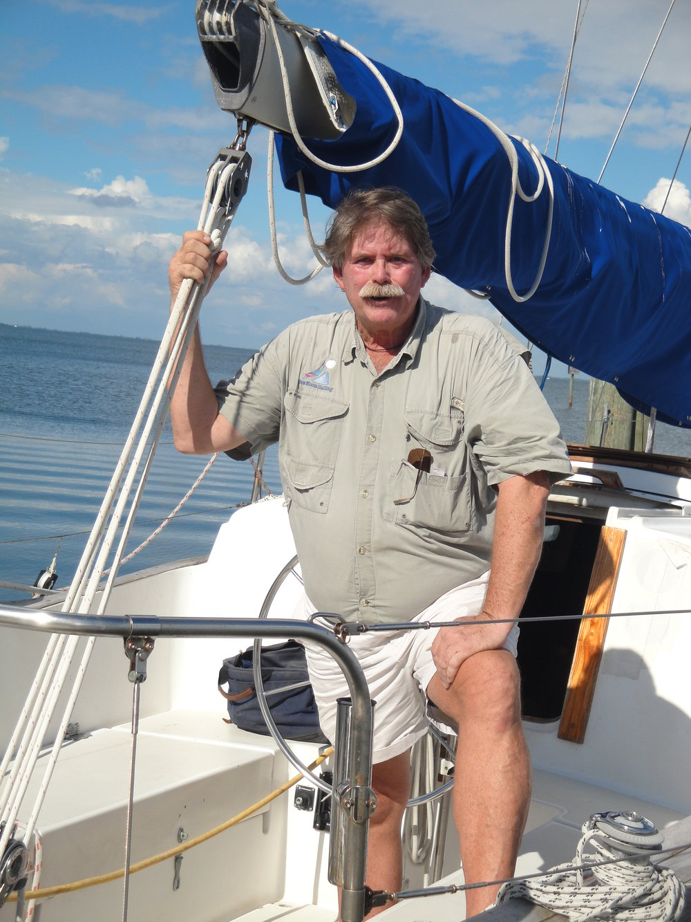 Captain Mick Gurley aboard the New Moon Sailboat.jpg