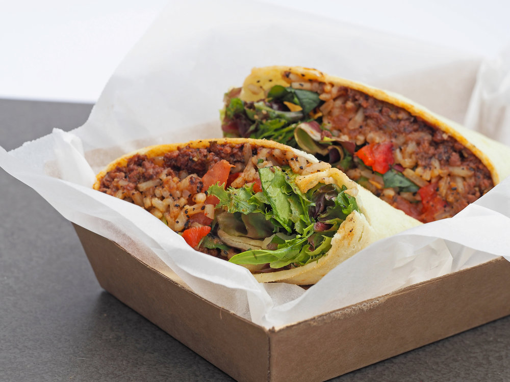 Native spiced roo mince burrito  served mission style with wattleseed rice, salad and cheese.