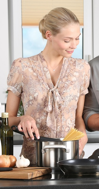 cropped image of woman in kitchen