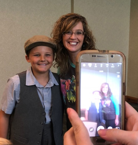 Child actor, Noah Henninger poses with April Childers (SAIL 2018) as we photograph them together!